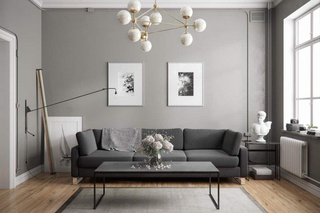 Sufragerie amenajata in stil contemporan cu elemente de decor gri si auriu plus tablouri si statuie